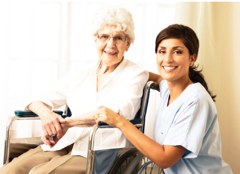 Home care specialist with senior woman in a wheelchair recovering from a hospital visit in Burlington, VT